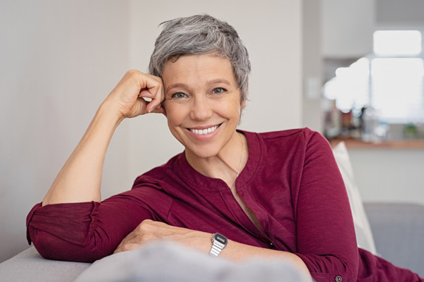 Mature woman smiling on a couch